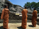 Three Monks in Front of a Statue of the Buddha  Gal Vihara  Polonnaruwa  Sri Lanka