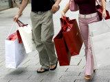 Couple Walking with Shopping Bags on Konigsallee  Dusseldorf  North Rhine Westphalia  Germany