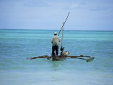 Man Sailing a Fishing Boat on the Indian Ocean  Zanzibar  Tanzania  East Africa  Africa