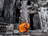 A Buddhist Monk Relaxes in the Bayon Temple  Angkor  Unesco World Heritage Site  Cambodia