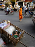 A Small Child Sleeps in a Cart on the Streets of Phnom Penh  Cambodia  Indochina