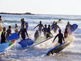 Teenage Surfers Running with Their Boards Towards the Water at a Life Saving Competition