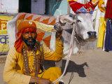 Hindu Holy Man with Five Legged Cow  Pushkar  Rajasthan State  India
