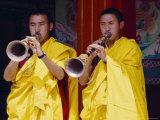 Monks Blowing Flutes Outside a Gompa (Tibetan Monastery)  Bodhnath  Katmandu  Nepal