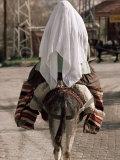 Muslim Woman on a Donkey  Goreme  Cappadocia  Anatolia  Turkey  Eurasia