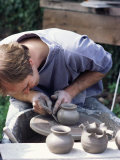 Potter at Work on Wheel at Rustic Fayre  Devon  England  United Kingdom