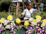 Carder Working on a Bedecked Floral Boat  Flowers Festival  Chiang Mai  Thailand