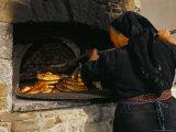 Greek Woman Baking Bread in Outdoor Communal Oven  Olymbos (Olimbos)  Karpathos  Dodecanese Islands