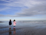 Boy Aged Four and Girl Aged Three on a Black Volcanic Sand Beach in Manawatu  New Zealand