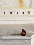 Tibetan Buddhist Monk Reading Scriptures at the Boudha Stupa at Bodhanath  Kathmandu  Nepal