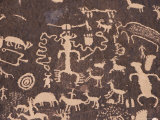 Indian Petroglyphs Drawn on Red Standstone by Scratching Away Dark Desert Varnish of Iron Oxides