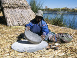 Uros (Urus) Woman Grinding Corn  Islas Flotantas  Reed Islands  Lake Titicaca  Peru  South America