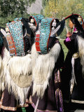 Ladakhi Women in Traditional Clothing  Yak-Skin Coat and Turquoise Head Dress  Ladakh  India