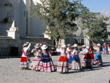 Girls in Traditional Local Dress Dancing in Square at Yanque Village  Colca Canyon  Peru