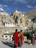Novice Monks Walk from Village  Lamayuru Monastery  Ladakh  India