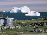 Painted Wooden Fisherman's House in Front of Icebergs in Disko Bay  Disko Island  Greenland