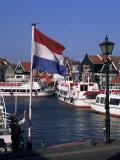 Raising the Dutch Flag by the Harbour  Volendam  Ijsselmeer  Holland