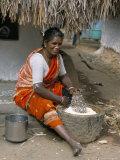 Village Woman Pounding Rice  Tamil Nadu  India
