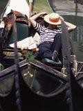 Gondolier Relaxing in Gondola  Venice  Veneto  Italy