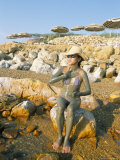 Woman Putting on Mud at the Dead Sea  Jordan  Middle East