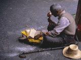 Tibetan Buddhist Pilgrim Reading Texts and Holding Prayer Wheel  Lhasa  China