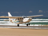 Plane About to Land on Seventy Five Mile Beach  Queensland  Australia
