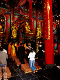 Monk and Devotees Praying at Yuantong Temple  Kunming  Yunnan  China