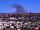 Smoke Billowing from a Smelter Stack with Mt Isa in the Foreground  Australia