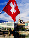 Swiss Flag on Mont Blanc Bridge with Quai General Guisan in Background  Geneva  Switzerland