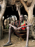 Karamojong Boy Sitting at Entrance to Hut  Uganda