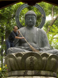 Man Cleaning a Buddha Statue  Shinnyo-Do Temple  Kyoto  Kinki  Japan