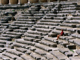 Aspendos Roman Theatre Seats and Seated Woman  Aspendos  Antalya  Turkey