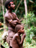 Man and Boy Watching Work  Oriomo Plateau  Western  Papua New Guinea