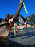 Fisherman on Longtail Boat About to Depart from Ao Ton Sai Beach  Ko Phi-Phi Don  Krabi  Thailand