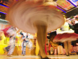 Swirling Skirts of Traditional Dancers in Motion at Pena Restaurant Huari  La Paz  Bolivia