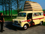 Modern Day Gypsy with His Antique Bedford Camper Van by Silbury Hill  Avebury  Wiltshire  England