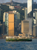 Star Ferry Crossing Hong Kong Harbour with the Towers of Hong Kong Island Beyond  Hong Kong  China