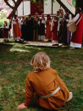 Woman Musicians Performing to Child at Festivitas Middle Ages Festival  Lund  Skane  Sweden