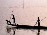 Two Men and a Dog in a Canoe  Silhouetted  Rabaul  East New Britain  Papua New Guinea
