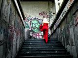 Woman Climbing Graffiti Stairwell  Belgrade  Serbia