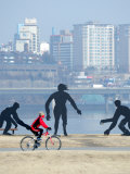 Person Cycling Past Sculptures on Han River Cycleway  Sinchon and Yeouido  Seoul  South Korea
