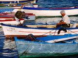 Fishermen Mending Nets in Boats on Costa del Azahar  Peniscola  Valencia  Spain