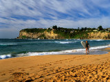 Surfer on Avalon Beach  Bilgola Headland in Background  Sydney  New South Wales  Australia