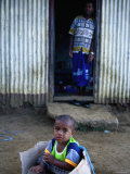 Young Boy Playing in Box Outside Home  Viti Levu  Western Division  Fiji