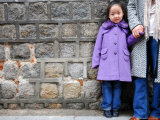 Young Girl Standing Against Stone Wall  Seoul  South Korea