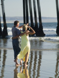 Couple on Beach Below Pier  Pismo Beach  California