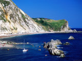 Yacht and Bathers in Man o' War Bay  Lulworth  Dorset  England