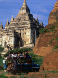 Crowded Pick-Up Carrying Passengers Past Thatbyinnyu Pahto  Old Bagan  Mandalay  Myanmar
