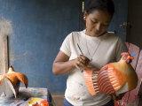 Woman Painting Balsa Wood Sculptures of Chickens  Rio San Juan  Nicaragua
