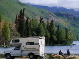 RV Camping Couple Stop for a Break on the Shores of Long Lake along the Glenn Highway  Alaska